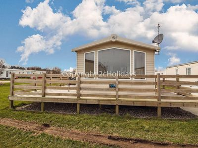 Photo for 8 berth caravan for hire with decking with a part seaview in Suffolk ref 20087