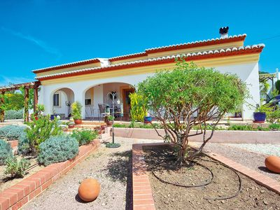 Photo for This 3-bedroom villa for up to 8 guests is located in Javea and has a private swimming pool, air-con