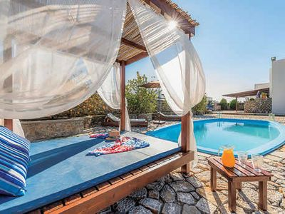 Photo for 4 bedroom villa, walking distance to shops, restaurants and beach, Ping-Pong, large swimming pool, barbecue and 4 poster day bed outside.
