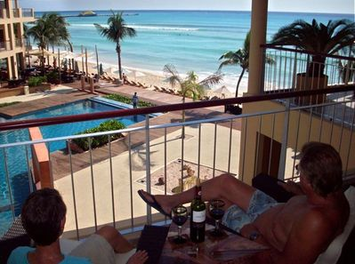 Enjoy Life from our balcony with a beautiful view and sunrises, too.