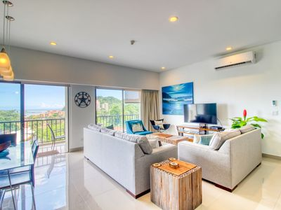 Photo for Luxury condo with a balcony, ocean and jungle views & open layout!