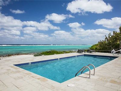 Photo for Thatch Hill: Snorkeling Haven in Rum Point with Oceanside Pool and Screened Porch