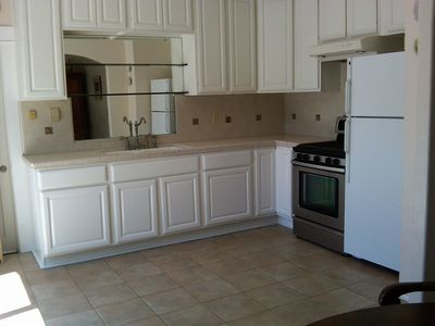 Full kitchen: stove, oven, dishwasher, refrigerator, with freezer.