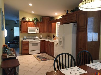 Kitchen with filtered water and ice maker in refrigerator.