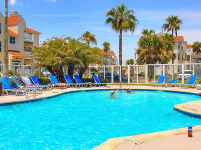 Photo for Comfortable, dog-friendly condo with a shared pool - two blocks to the beach!