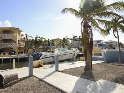 Photo for Canal-front, family-friendly home w/ soaking tub, dock access & water view!