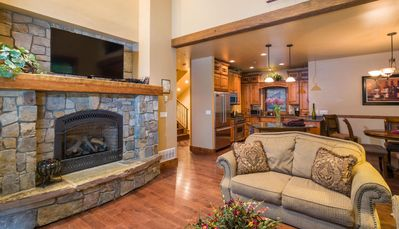 Main floor living room view of TV & Fireplace