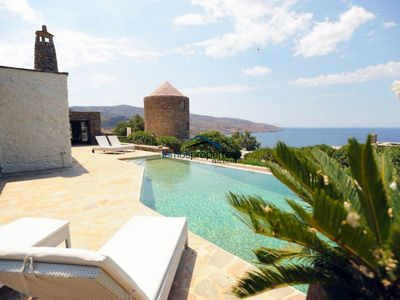 Photo for Unique stone villa with a swimming pool and sea view in Koundouros