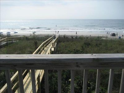 View from the upper deck with table, chairs & umbrella,plus deck chairs