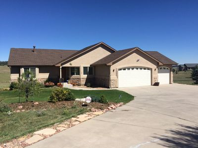 Photo for Beautiful home set in 2 1/2 acres, close to I-25 and 20 minutes from USAFA