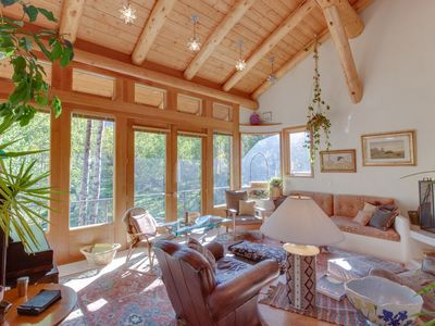 Photo for NEW LISTING! Charming dog-friendly lodge w/fireplace, big deck & beautiful view