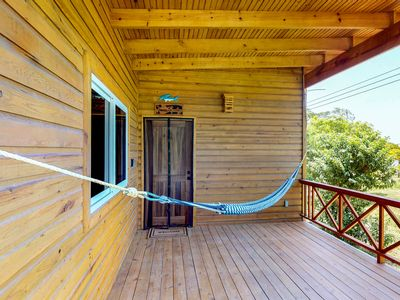 Photo for Cabin in nature with private dock and hammock & views of the yard and ocean