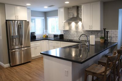 Gourmet Kitchen, quartz counter tops, stainless steel appliances, fully stocked