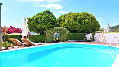 Photo for Self contained studio with private swimming salt water pool, garden and BBQ.