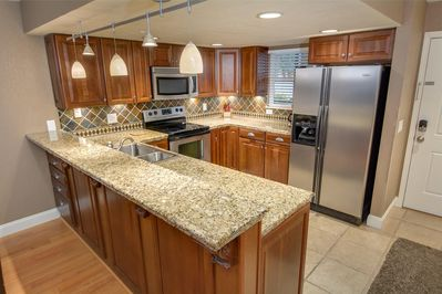 Stunning Kitchen with cherry cabinetry and stainless appliances.