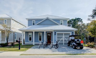 Photo for Spacious Home With Private Pool & Golf Carts! Walk To Beach! 'Family Tides'