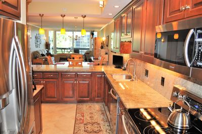 Ample counter space, contemporary lighting, upscale appliances