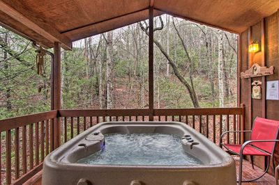 Up to 4 guests can enjoy soaking in the views from the private hot tub.