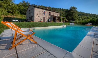 Photo for At the Edge of a Forest 17th Century Stone Farmhouse with Pool - Family Friendly