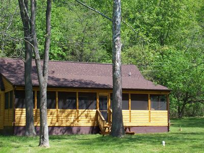 Cabin from the back yard. Large screened in porch.