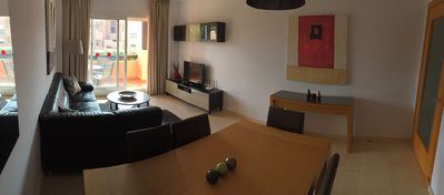 Panoramic view of spacious lounge and dining area.