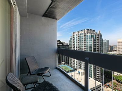 Photo for High-rise apartment in heart of downtown w/ shared pool/gym & great view!