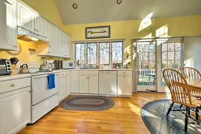 The fully equipped kitchen opens up to the private deck through French doors.