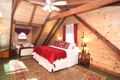 Master king bedroom with soaring beams and luxury pillowtop mattress