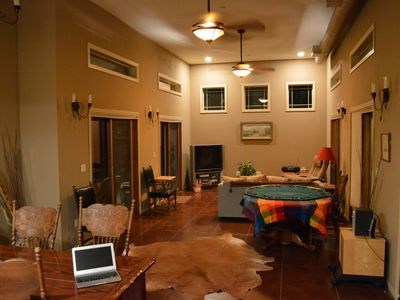 Great room, poker table, seating for 8, cow rug, fans and flat screen TV, MP3