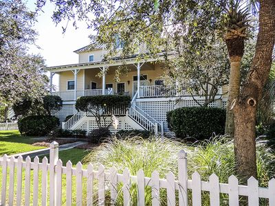 Photo for Screened porches, decks, rockers, hammocks and an upstairs balcony with ocean views