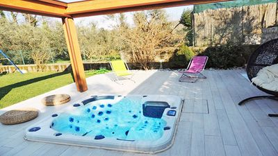 Photo for Pretty apartment with Jacuzzi hot-tub, solarium, parking and garden furniture