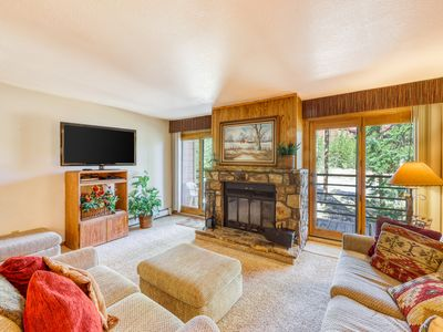 Photo for Pristine condo with cozy fireplace & shared pool/hot tub!
