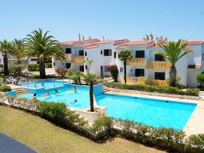 Photo for APARTMENT WITH TWO BEDROOMS, POOL, PLAYGROUND AND GARDEN