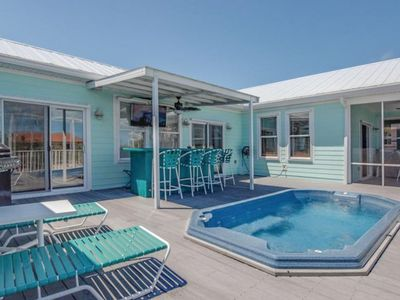 Photo for NEW LISTING! Canal front home with dock, quick ocean access and a hot tub!