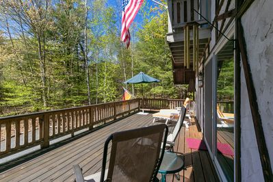 The sunny deck faces south; 2 lounges, 2 anti-grav chairs, table for 8