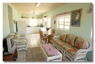 Your 'Tropical Blue' 2 bdrm/ 2 bath living/ dining room area!