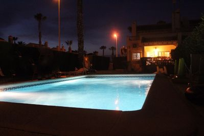 Private swimming pool at night ......