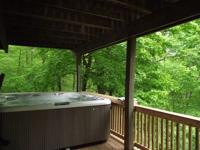 Photo for Cozy home on Haven! Outdoor Hot Tub, Woodburning Fireplace, Snuggle In!