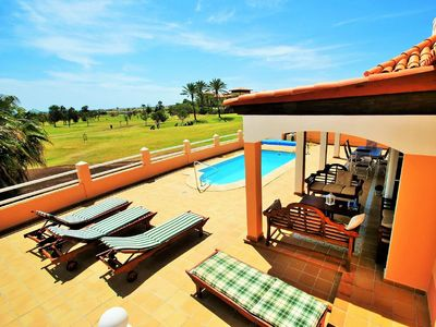 Photo for Beautiful villa with pool and views to sea and golf course