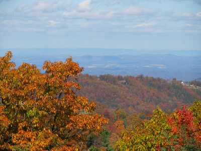 Northern autumn view from upper deck of Pigeon Forge in the distance.