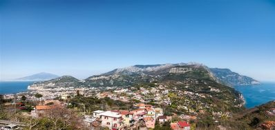 Photo for Villa Due Golfi offers a breathtaking view of the Sorrento Peninsula with Mount Vesuvius in front of