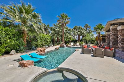 Gorgeous backyard with pool, spa, fire table, BBQ, misting system, and ample seating for dining and lounging!