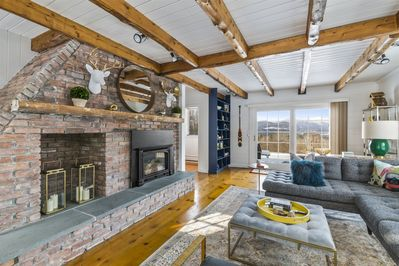 Spacious living room with plenty of natural light and fireplace