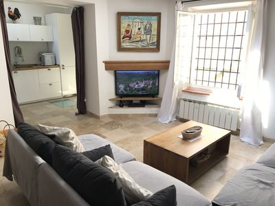 Main sitting area with kitchen in background. TV with Magbox, Netflix & Blu-ray