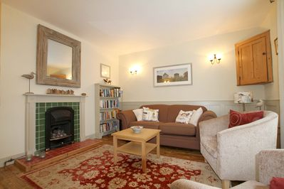 Comfortable sitting room with TV and DVD and cosy gas fireplace.