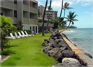 The grassy area and ocean in front of the condo