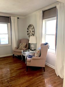 The living room is full of relaxing and comfortable seating with plenty of room.