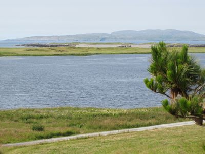 View from front of house of lake, par 3 golf course, ocean and Inishturk Island.