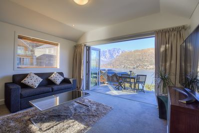 Stunning views of Lake Wakatipu, The Remarkables mountains from the open-flow entertainment lounge, kitchen and dining room. Two sets of fully opening doors lead onto the private balcony. Fully double glazed.