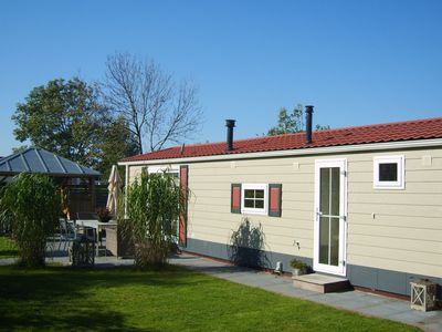Photo for A comfortable chalet with an outdoor jacuzzi on a holiday park by the Waddenzee